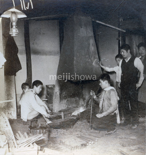 91204-0005 - Blacksmith at Work