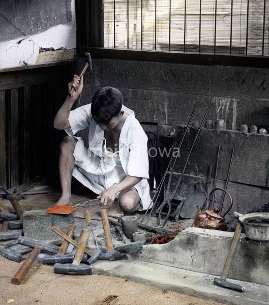 91204-0008 - Blacksmith at Work
