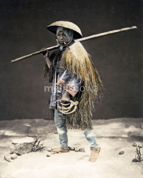 120207-0031-PP - Farmer in Straw Raincoat
