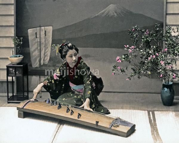 120207-0071-PP - Woman Playing Koto